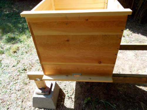 Note the lower entry and 2 inch deep landing strip.  The metal strip above the entry is a mouse guard.  The upper landing strip is also attached to the brood box.