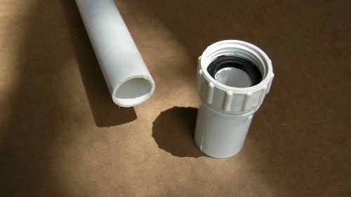 The garden hose adapter slips on the length of PVC.  Use the thinner type of PVC (cheaper as well) because you'll be drilling holes in it and it doesn't have to hold pressure.