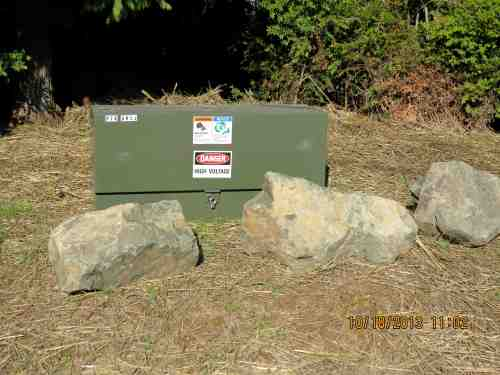 Boulders  protecting box, grass growing already.  Well done!