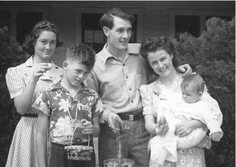 Around 1940, Mom is holding my oldest sister, Ellen, Dad is looking on, and Dad's sister, Betty, and brother, Bob, to his right.