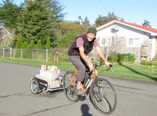 At about 9 am, fresh bread gets delivered by bicycle to the natural foods store.