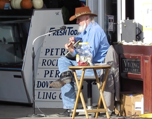 "It was one of those perfect days when everyone was in a good mood with the weather being warm, artists selling their crafts, and Kirk Schumacher strumming his guitar.  I asked Kirk if he would sing one of my favorite summertime songs.  Without missing a beat, he he belted out ""Summertime."""
