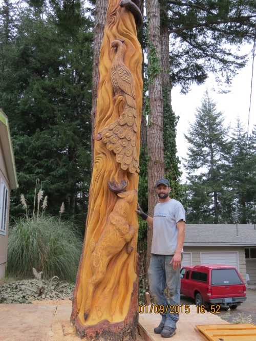 Brian Vorwaller poses with the finished totem