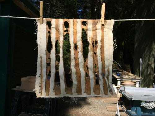 I took a photo of this old 'quilt' taken from a Warré hive.  You can see where the bees have chewed spaces (I assume) for ventilation into the box above that's full of sawdust.  The upper box has another 'quilt' to keep the sawdust from falling into the interior of the hive.   When you let the bees build their own comb (I don't use any wax foundation or heaven forbid any plastic foundation) they are free to decide where to put holes in the comb for whatever purpose they want, be it ventilation or for just passing through  the comb.