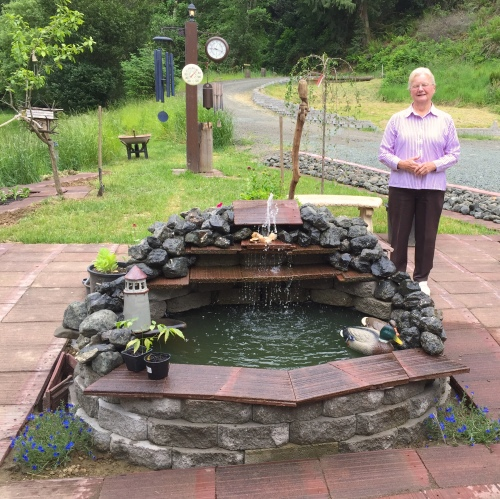 Patti, a young 80 year-old,  built this fountain and pond completely by herself.