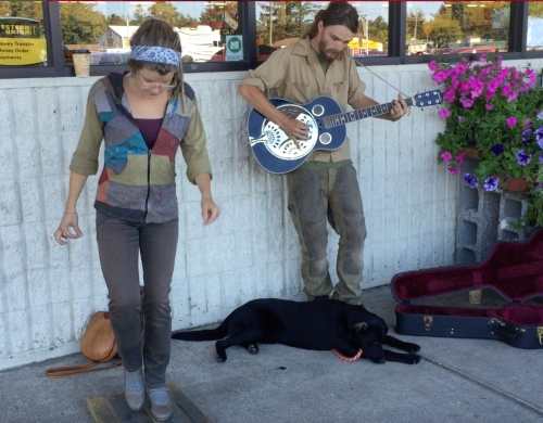 June 19...Unidentified street performers provide the perfect background music for the bee gathering poppy pollen video.