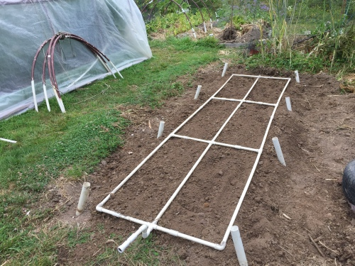 July 9...The drip water grid is in place. We're ready to plant.