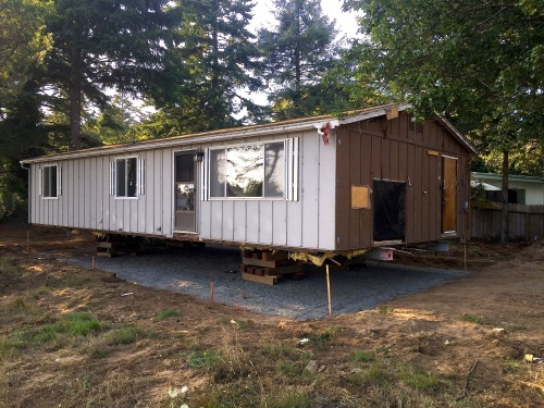 The house has been moved to new location...intact and ready for plumbing.