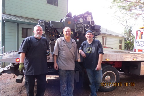 The moving crew of Joe, John, and Shaun pictured after they successfully loaded the 3.5 ton Heidelberg KORD 64 onto the truck.